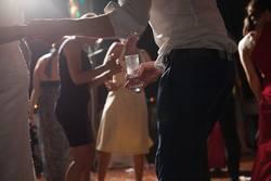 bride and groom dancing in backlit