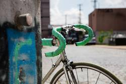 vintage racing bike leaning against wall in urban surrounding