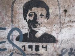 Graffiti showing a person looking like Zuckerberg with 1984