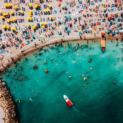 Aerial Drone View Of People Having Fun And Relaxing On Costinesti Beach In Romania At The Black Sea