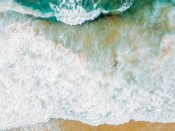 Aerial Panoramic Drone View Of Blue Ocean Waves Crushing On Sandy Beach in Portugal