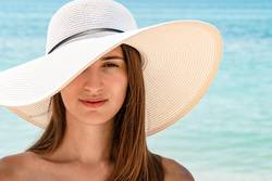 Young Woman Portrait With White Beach Hat