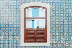 Vintage Wooden Window On Blue Tile Wall In Lisbon, Portugal