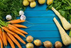 Border of assorted fresh healthy farm vegetables