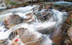 there is a bicycle in the river