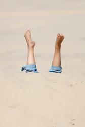 Kopfüber im Sand