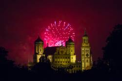 fireworks over the illuminated Augsburg Town Hall