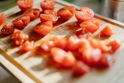 Chopped tomatoes on a cutting board