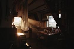 beautiful evening light shining through window of a cottage
