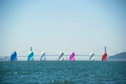 racing sailboats in a row