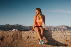 Sportswoman resting sitting