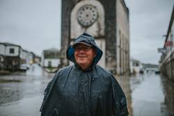 Smiling senior man wearing a rain coat