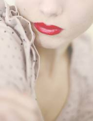 rosa Rüschchen mit Pünktchen, rotes Schnütchen...