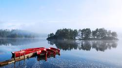 red boat lake fog