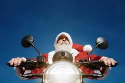 Weihnachtsmann auf dem Motorrad