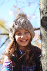 Beautiful smiling girl on the autumn tree