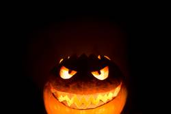 Bottom halloween pumpkin smile with hot burning fire eyes mouth
