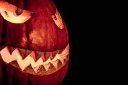 Side view halloween pumpkin smile with fire burning eyes mouth