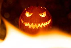Fire flames halloween pumpkin smile with hot burning eyes mouth