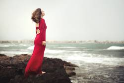 pensive woman on the beach