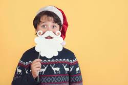 Child Wearing Christmas Santa Claus Hat and beard