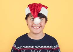 funny Child Wearing Christmas Santa Claus Hat