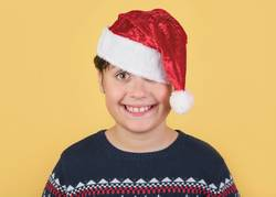 Child Wearing Christmas Santa Claus Hat