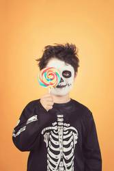 Happy Halloween.funny child in a skeleton costume
