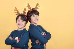 smiling children in a Rudolph Reindeer christmas costume