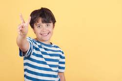 child smiling doing victory sign.Number two