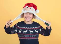 smiling Child Wearing Christmas Santa Claus Hat