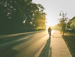 Early morning bike ride in sunrise