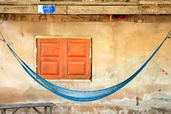 Blue hammock in front the house