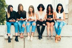 Big Group of friends using cellphones.