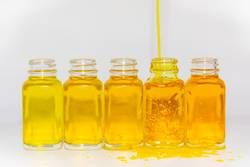 Different shades of yellow fluid in bottles
