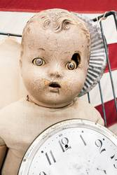 Old vintage doll with damaged face