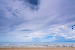 Clouds in the bright blue sky over sea