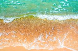 Bubble of clear sea wave on the beach