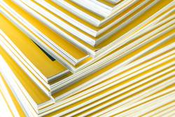 Stack of yellow monthly magazine