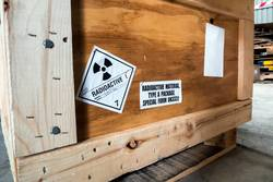 Radiation label beside the transport wooden box