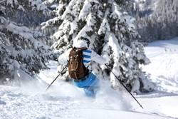 Skier skiing off piste. Powder. Freeski. Freeride