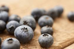 close up of blueberry on vintage, wooden table