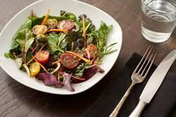 fresh salad on nice wooden table