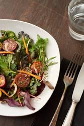 fresh salad on dark wooden table