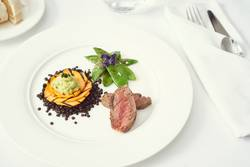 dinner with beef on a pure white dinner plate