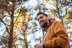 Portrait of a smiling man with autumnal background.