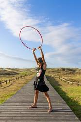 girl with hoop on the beach