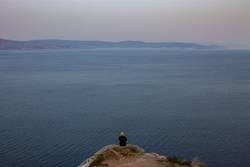 man and sea at the coast