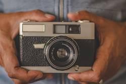 vintage photo camera in hands