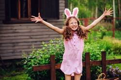 easter portrait of happy child girl in bunny ears